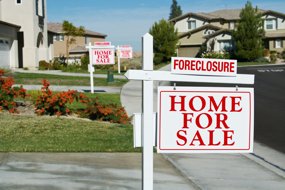 Row of homes all in foreclosure