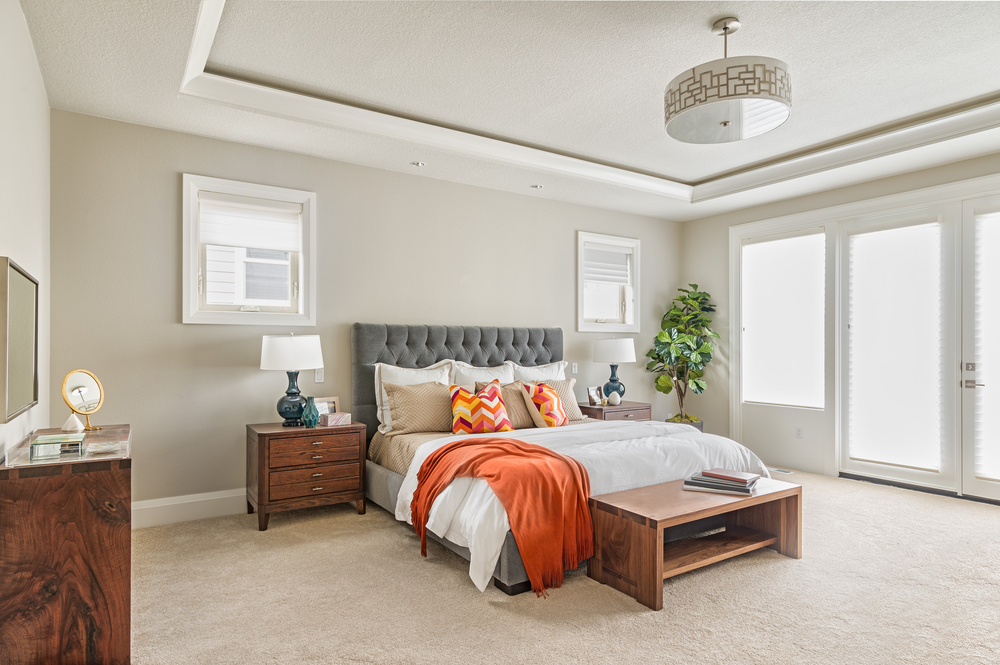 Master bedroom staged with simple items
