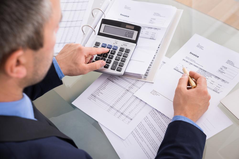 Man calculating rehab costs