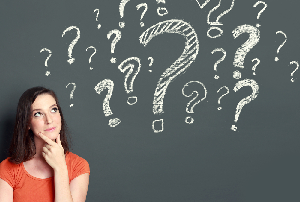 Woman with question marks over head
