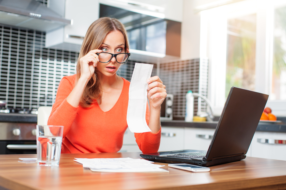 Woman budgeting at kitchen table