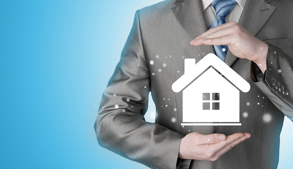 Man holding home icon