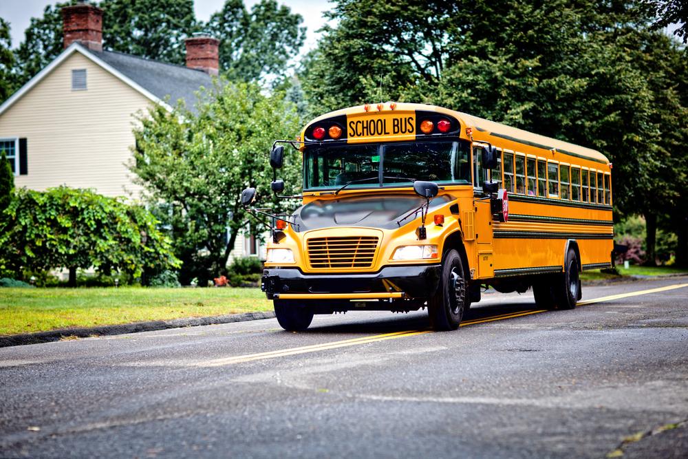 School bus driving through neighborhood