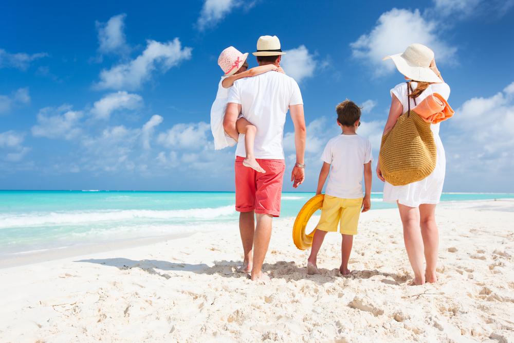 Family on white sand beach