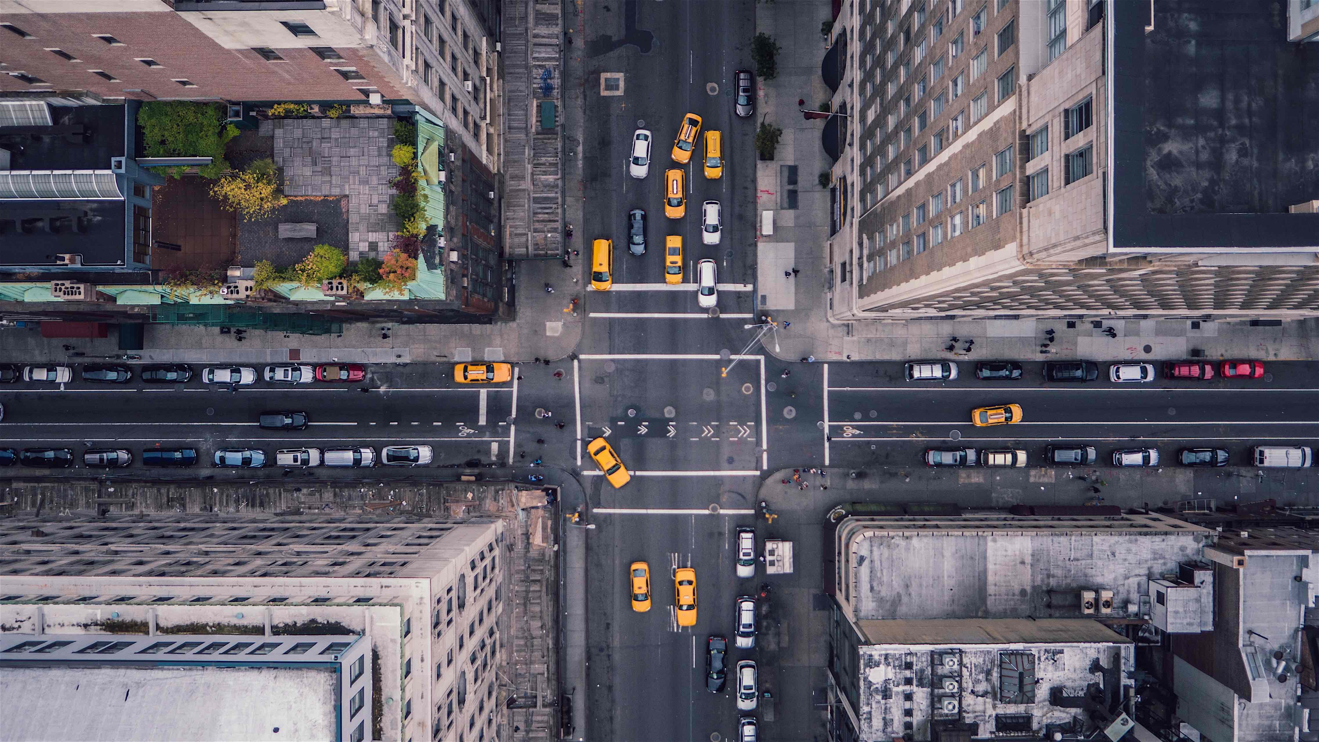 A camera plummets toward the ground, destined to smash into a crowded intersection in New York.