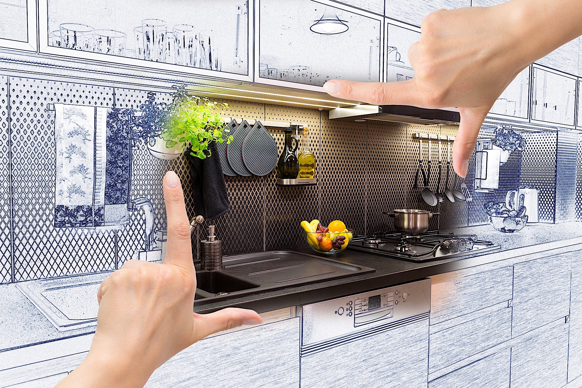Female hands framing custom kitchen design. Combination drawing and photo.